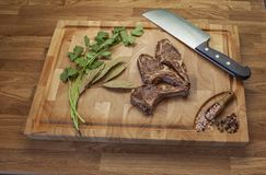 Lamb meet ribs on the cutting board royalty free stock photo