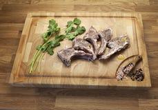 Lamb meet ribs on the cutting board royalty free stock photos