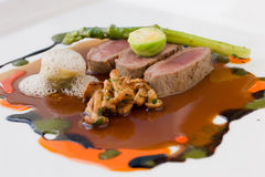 Lamb, mushrooms, asparagus and broccoli Stock Photography