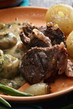 Lamb with onions and mushrooms closeup Stock Image