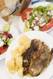 Lamb in the paper greek island taverna food Royalty Free Stock Photography