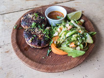 Lamb patties and salad on a rustic dish Royalty Free Stock Image