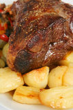 Lamb, potatoes and veg. Roast leg of lamb with roast potatoes and stir-fried veg on a plate Royalty Free Stock Photo