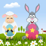 Lamb & Rabbit with Easter Eggs in Meadow Stock Photography
