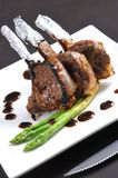 Lamb rack. Grill lamb rack with black pepper source Stock Photo