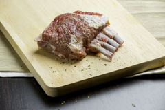 Lamb Rack. On the chopping board Stock Image