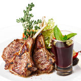Lamb rack with garnish. Fried lamb rack with vegetable garnish. Lamb chop dinner Stock Photo