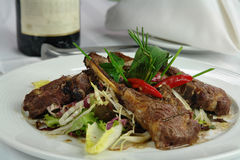 Lamb rib chops. Roasted lamb rib chops on a table plate with vegetables and peppermint Stock Photo