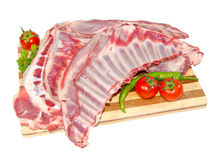 Lamb ribs. With tomato, pepper and parsley on a cutting board Royalty Free Stock Photo