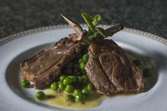 Lamb ribs with green peas Stock Photography