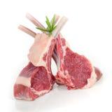 Lamb ribs. Rare lamb ribs isolated with rosemary Stock Images