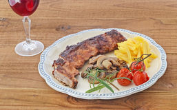 Lamb ribs and red wine Stock Images