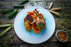Lamb ribs with sweet potato parmentier recipe Stock Images