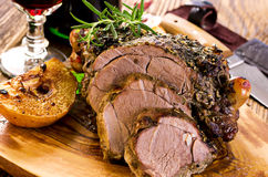 Lamb Roast. As closeup on a wooden board Stock Image