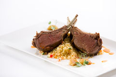 Lamb roast. With couscous and carrot saucee Royalty Free Stock Image