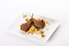 Lamb roast. With couscous and carrot saucee Stock Photos