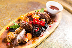 Lamb roast with plums royalty free stock image