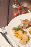 Lamb and roasted potato. Served on white plate Royalty Free Stock Photography
