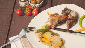 Lamb and roasted potato. Served on white plate Stock Photos