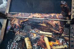 Lamb roasted on a spit, a city holiday royalty free stock images