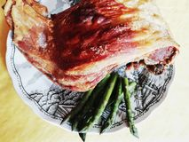 Lamb roasting with asparagus stock photography