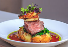 Lamb Rump medium, creamy garlic mash, haloumi. Seared Lamb Rump medium, creamy garlic mash, haloumi, spinach, red wine jus, parsley oil, micro herbs Royalty Free Stock Photos