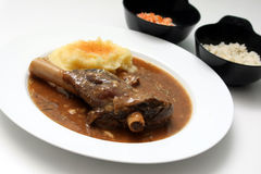 Lamb shank. A plate of lamb shank with potato and rice royalty free stock images