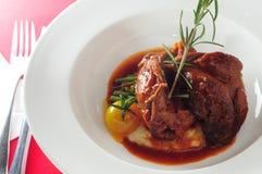 Lamb shank. Italian cuisine stewed lamb shank Royalty Free Stock Image