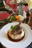 Lamb Shank. At a table setting stock images