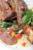 Lamb shank. With mashed potato on white plate Royalty Free Stock Image