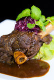 Lamb shank braised in an onion jus Royalty Free Stock Image