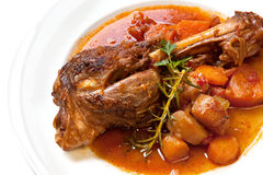 Lamb Shank Dinner. Slow-cooked lamb shank with vegetables.  Delicious, homely goodness Royalty Free Stock Images