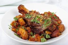 Lamb Shank Dinner. Lamb shank casserole, with parsley and lemon Royalty Free Stock Photos