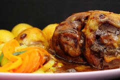 Lamb shank dinner meal Royalty Free Stock Images