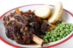 Lamb shank meal with peas and potato Royalty Free Stock Images