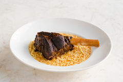 Lamb Shank with rice. In a white bowl on marble surface stock photography