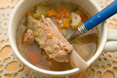 Lamb shank vegetable soup Stock Images