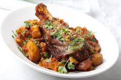 Lamb Shanks. Lamb shank dinner, with vegetables, topped with parsley and lemon rind royalty free stock image