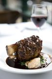 Lamb shanks with red wine Stock Image