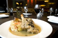 Lamb shanks with red wine. At nice restaurant Royalty Free Stock Photo