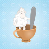 Lamb sitting in a cup with a spoon. Lamb sitting in a cup Stock Images