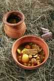 Lamb Soup Piti or Putuk with Cherry Plums in Vintage Ceramic Bowl. Homemade Lamb Soup Piti or Putuk with Cherry Plums in Vintage Ceramic Bowl on Rustic stock image