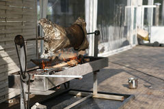 Lamb on the spit. Delicious roast lamb on a spit over an open fire Stock Images