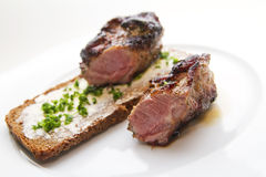 Lamb steak. Medium lamb steak with bread Royalty Free Stock Photos