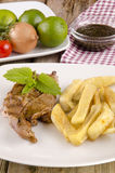 Lamb steak with french fries Royalty Free Stock Photo