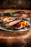 Lamb steak with garlic Stock Photography