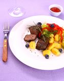 Lamb steak with gnocchi, vegetable and sauce Royalty Free Stock Images