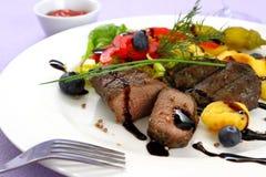 Lamb steak with potato, vegetable and balsamic sauce Stock Photo