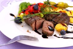 Lamb steak with potato, vegetable and black sauce Stock Image