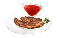 Lamb steak on ribs with thai sauce Royalty Free Stock Photo